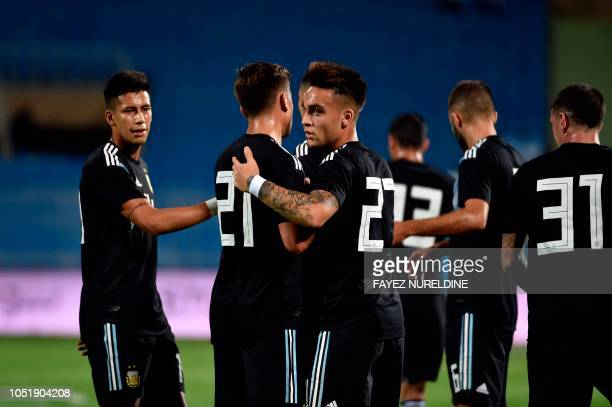 Argentina's Lautaro Martinez celebrates his goal with teammates during a friendly football match between Argentina and Iraq at the Faisal bin Fahd...