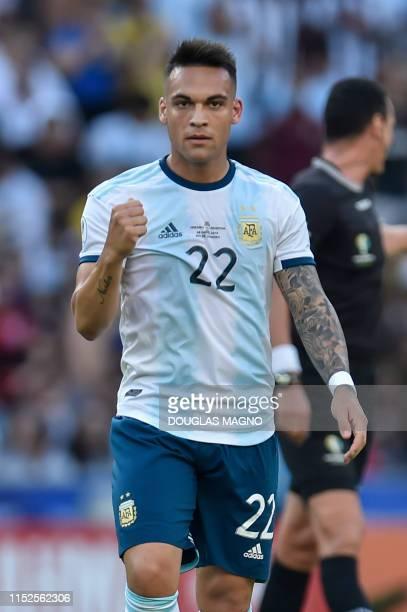 Argentina's Lautaro Martinez celebrates with teammates after scoring against Venezuela during their Copa America football tournament quarter-final...