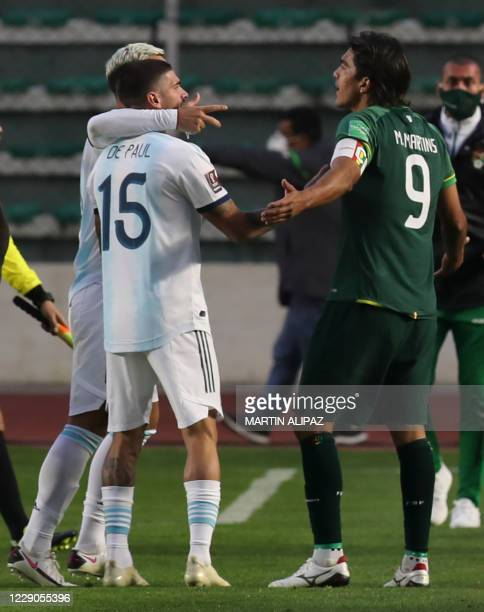 Argentina's Leandro Paredes and Rodrigo De Paul argue with Bolivia's Marcelo Martins during their 2022 FIFA World Cup South American qualifier...