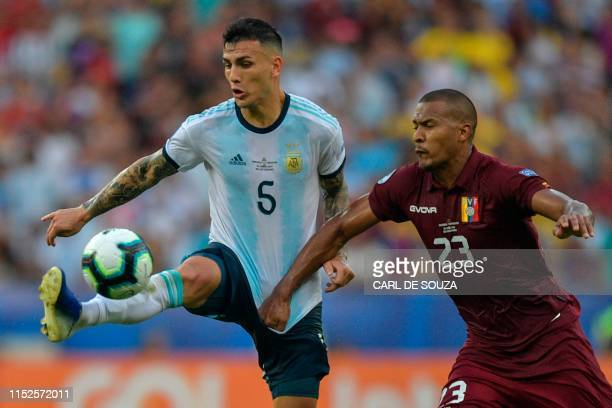 Argentina's Leandro Paredes and Venezuela's Salomon Rondon vie for the ball during their Copa America football tournament quarterfinal match at...