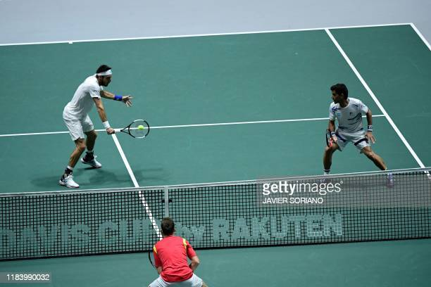 Argentina's Leonardo Mayer and Argentina's Maximo Gonzalez return the ball to Spain's Marcel Granollers and Spain's Rafael Nadal during the doubles...