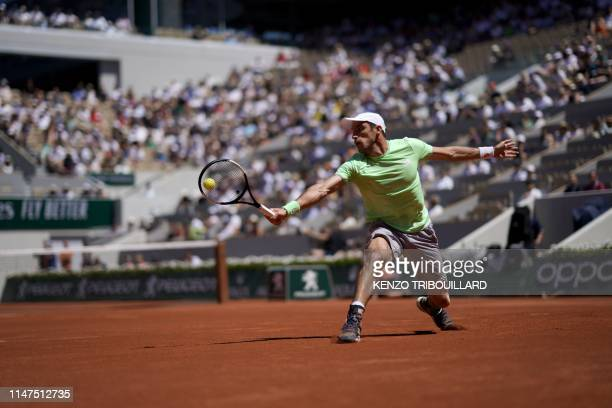 Argentina's Leonardo Mayer plays a backhand return to Switzerland's Roger Federer during their men's singles fourth round match on day eight of The...