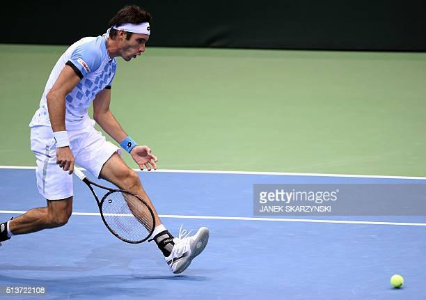 Argentina's Leonardo Mayer returns the ball to Poland's Hubert Hurkacz during Davis Cup World Group firstround between Poland and Argentina on March...