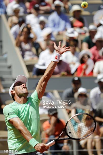 Argentina's Leonardo Mayer serves the ball to Switzerland's Roger Federer during their men's singles fourth round match on day eight of The Roland...