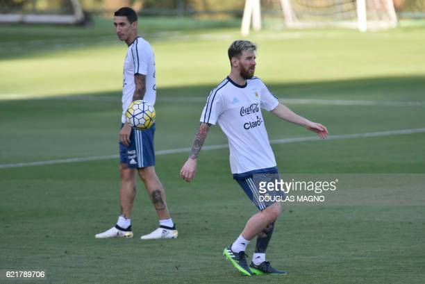 Argentina's Lionel Messi and Angel di Maria attend a training session of the national foorball team at the Atletico MG Training Centre in Vespasiano...