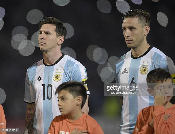 Argentina's Lionel Messi and Argentina's Lucas Biglia listen to the national anthem before their Russia 2018 FIFA World Cup South American...