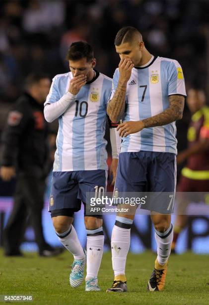 Argentina's Lionel Messi and Argentina's Mauro Icardi leave the field in the halftime during their 2018 World Cup qualifier football match in Buenos...