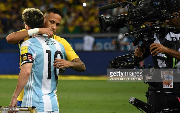 TOPSHOT Argentina's Lionel Messi and Brazil's Neymar greet each other before the start of their 2018 FIFA World Cup qualifier football match in Belo...