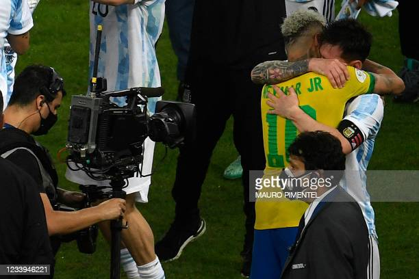 Argentina's Lionel Messi and Brazil's Neymar hug each other after the Conmebol 2021 Copa America football tournament final match at the Maracana...