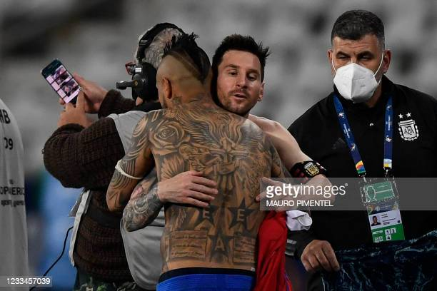 Argentina's Lionel Messi and Chile's Arturo Vidal greet each after tying 1-1 in their Conmebol Copa America 2021 football tournament group phase...