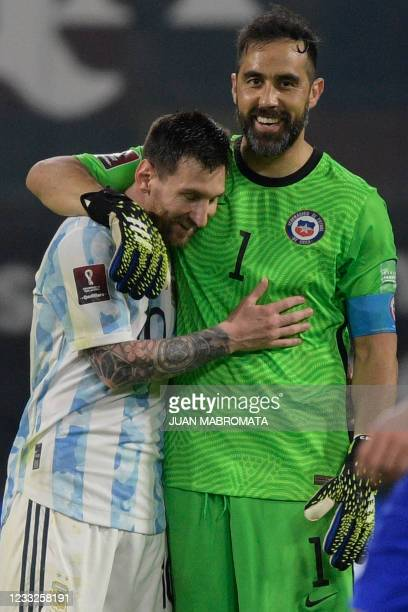 Argentina's Lionel Messi and Chile's goalkeeper Claudio Bravo greet each other after tying 1-1 in their South American qualification football match...