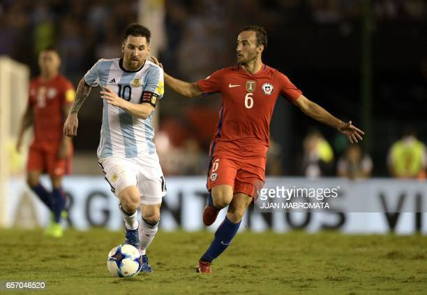 Argentina's Lionel Messi and Chile's Jose Pedro Fuenzalida vie for the ball during their 2018 FIFA World Cup qualifier football match at the...