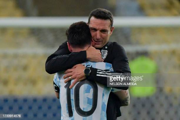 Argentina's Lionel Messi and coach Lionel Scaloni embrace after winning the Conmebol 2021 Copa America football tournament final match against Brazil...
