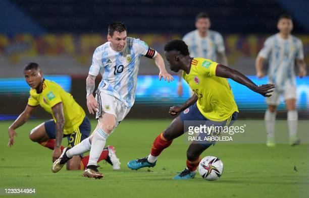 Argentina's Lionel Messi and Colombia's Davinson Sanchez vie for the ball during their South American qualification football match for the FIFA World...
