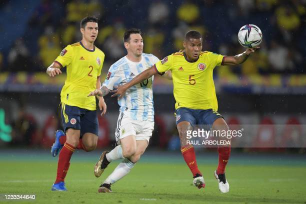 Argentina's Lionel Messi and Colombia's Wilmar Barrios vie for the ball during their South American qualification football match for the FIFA World...