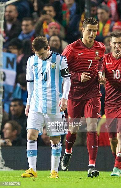 Argentina's Lionel Messi and Cristiano Ronaldo of Portugal during the international friendly football match between Argentina and Portugal at Old...