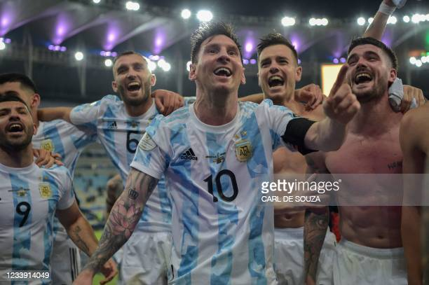 Argentina's Lionel Messi and teammates celebrate after winning the Conmebol 2021 Copa America football tournament final match against Brazil at...