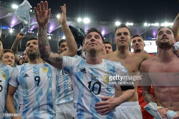 Argentina's Lionel Messi and teammates Sergio Aguero , Giovani Lo Celso and Rodrigo De Paul celebrate after winning the Conmebol 2021 Copa America...