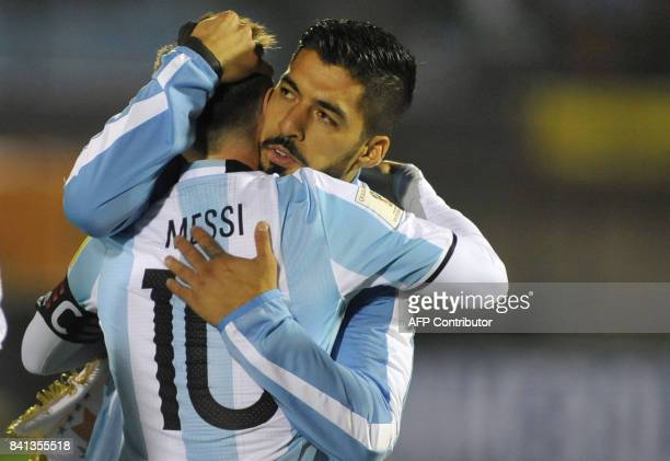 TOPSHOT Argentina's Lionel Messi and Uruguay's Luis Suarez greet each other at the end of their 2018 World Cup qualifier football match in Montevideo...