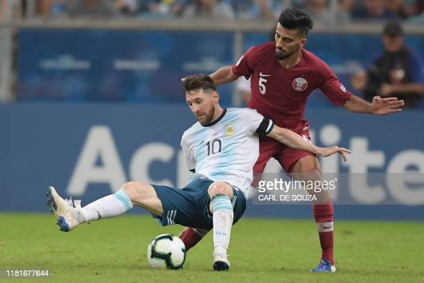 TOPSHOT Argentina's Lionel Messi and vie for the ball during their Copa America football tournament group match at the Gremio Arena in Porto Alegre...