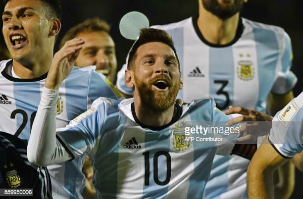 Argentina's Lionel Messi celebrates after defeating Ecuador and qualifying to the 2018 World Cup football tournament, in Quito, on October 10, 2017....