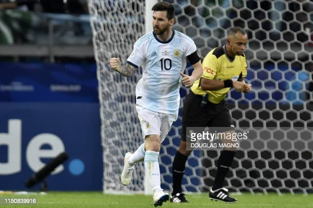 Argentina's Lionel Messi celebrates after scoring a penalty against Paraguay which was awarded by the VAR after a hand in the area during their Copa...
