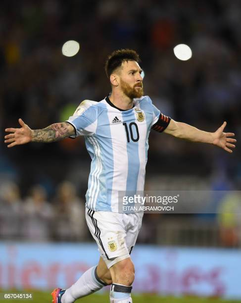 Argentina's Lionel Messi celebrates after scoring against Chile during their 2018 FIFA World Cup qualifier football match at the Monumental stadium...