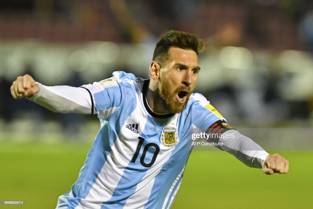 Argentina's Lionel Messi celebrates after scoring against Ecuador during their 2018 World Cup qualifier football match in Quito, on October 10, 2017. / AFP PHOTO / Juan Ruiz