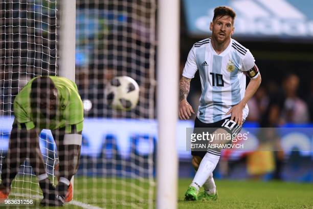 Argentina's Lionel Messi celebrates after scoring against Haiti during their international friendly football match at Boca Juniors' stadium La...