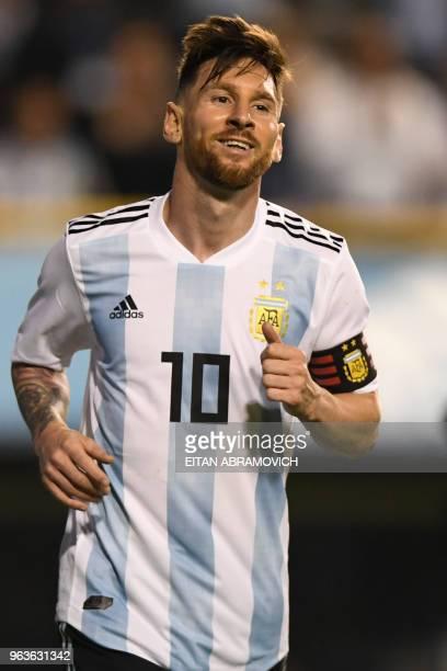 Argentina's Lionel Messi celebrates after scoring against Haiti during their international friendly football match at Boca Juniors' stadium La...