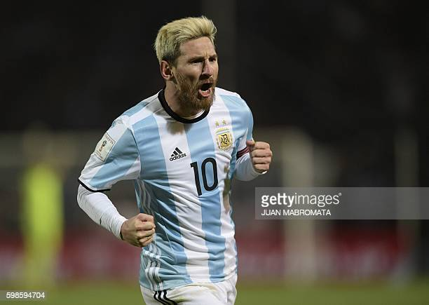 Argentina's Lionel Messi celebrates after scoring against Uruguay during the FIFA World Cup 2018 qualifier football match between Argentina and...