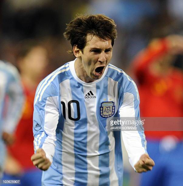 Argentina's Lionel Messi celebrates after scoring their first goal against Spain during a friendly football match to preparation for the 2010 World...