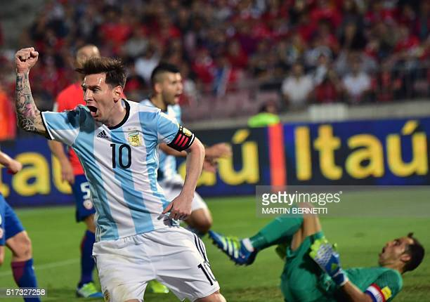 Argentina's Lionel Messi celebrates the team's second goal as Chile's goalkeeper Claudio Bravo gestures during their Russia 2018 FIFA World Cup South...