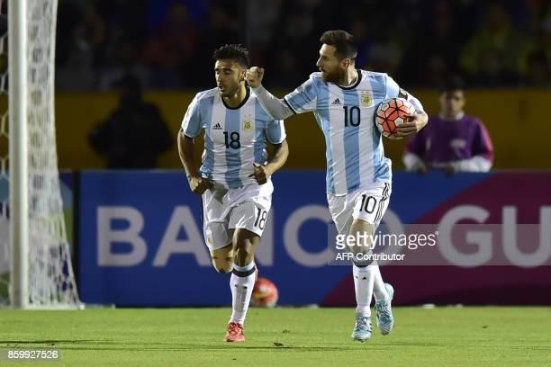 Argentina's Lionel Messi celebrates with teammate Eduardo Salvio after scoring against Ecuador during their 2018 World Cup qualifier football match...