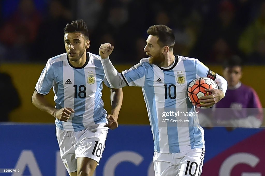 Argentina's Lionel Messi (R) celebrates with teammate Eduardo Salvio after scoring against Ecuador during their 2018 World Cup qualifier football match in Quito, on October 10, 2017. / AFP PHOTO / Rodrigo BUENDIA