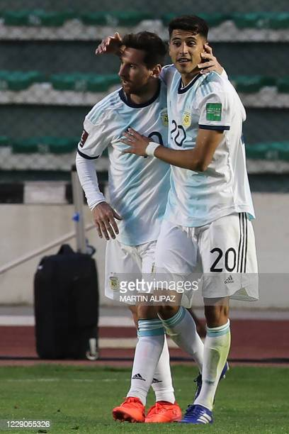 Argentina's Lionel Messi celebrates with teammate Exequiel Palacios after defeating Bolivia 2-1 in their 2022 FIFA World Cup South American qualifier...