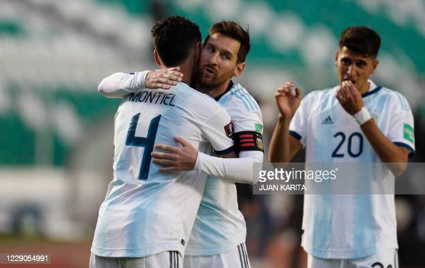 Argentina's Lionel Messi celebrates with teammate Gonzalo Montiel after defeating Bolivia 2-1 in their 2022 FIFA World Cup South American qualifier...