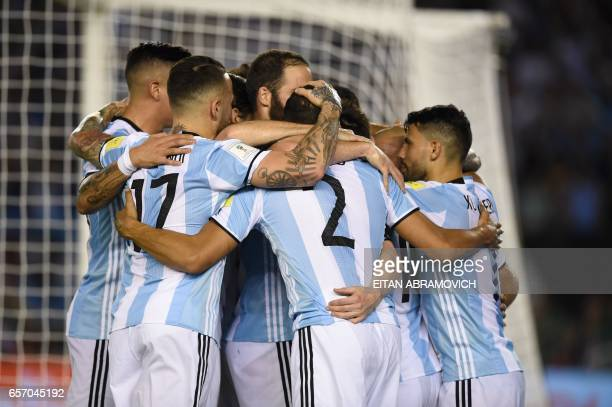 Argentina's Lionel Messi celebrates with teammates after scoring against Chile during their 2018 FIFA World Cup qualifier football match at the...
