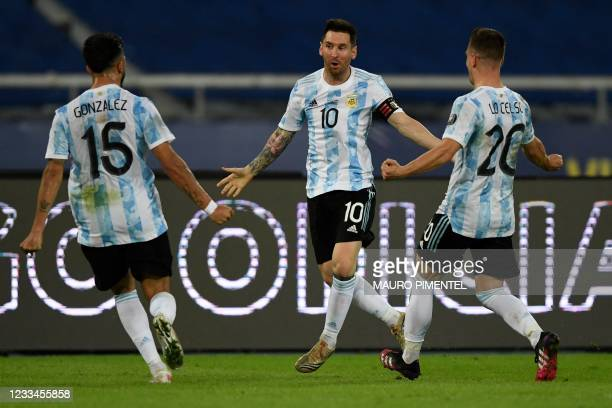 Argentina's Lionel Messi celebrates with teammates Nicolas Gonzalez and Giovani Lo Celso after scoring a free-kick against Chile during their...