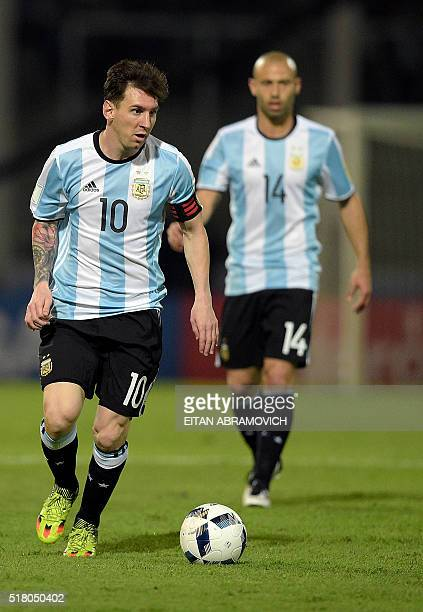 Argentina's Lionel Messi controls the ball next to teammate Javier Mascherano during their Russia 2018 FIFA World Cup South American Qualifiers'...