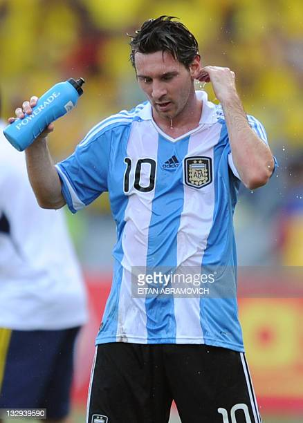 3b9508f5e8 Argentina's Lionel Messi cools himself down during the Brazil 2014 FIFA  World Cup South American qualifier