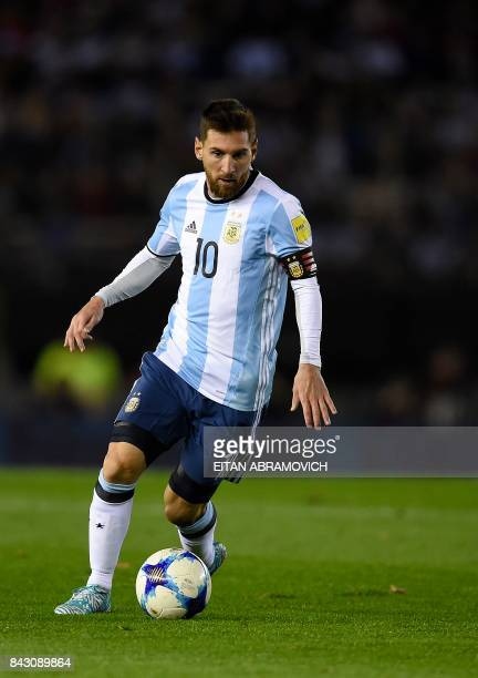 Argentina's Lionel Messi drives the ball during the 2018 World Cup qualifier football match against Venezuela in Buenos Aires on September 5 2017 /...