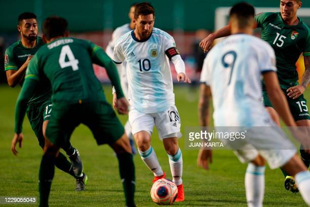 Argentina's Lionel Messi drives the ball during the 2022 FIFA World Cup South American qualifier football match against Bolivia at the Hernando Siles...