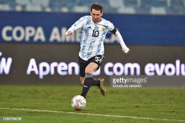 Argentina's Lionel Messi drives the ball during the Conmebol Copa America 2021 football tournament group phase match against Bolivia, at the Arena...