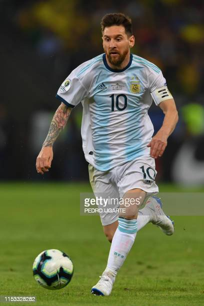 Argentina's Lionel Messi drives the ball during the Copa America football tournament semi-final match against Brazil at the Mineirao Stadium in Belo...