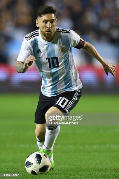 Argentina's Lionel Messi drives the ball during the international friendly football match against Haiti at Boca Juniors' stadium La Bombonera in...
