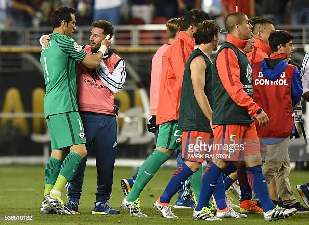 Argentina's Lionel Messi embraces teammate goalkeeper Sergio Romero after a Copa America Centenario football match against Chile in Santa Clara...
