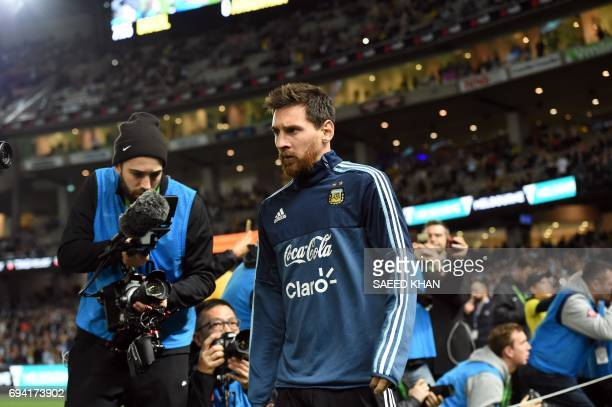 Argentina's Lionel Messi enters the ground before the friendly international football match between Brazil and Argentina at the MCG in Melbourne on...