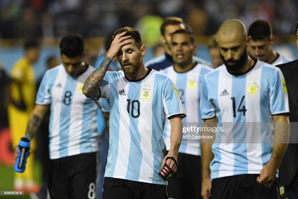 Argentina's Lionel Messi (C) gestures at the end of the goalless 2018 World Cup qualifier football match against Peru in Buenos Aires on October 5, 2017. / AFP PHOTO / Eitan ABRAMOVICH