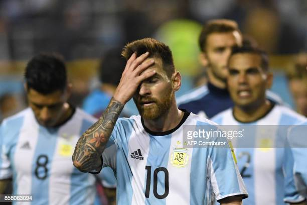 TOPSHOT Argentina's Lionel Messi gestures at the end of the goalless 2018 World Cup qualifier football match against Peru in Buenos Aires on October...